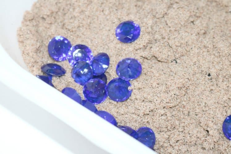 small jewels in sand
