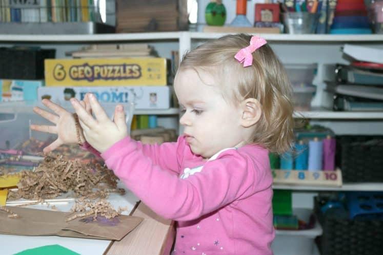 toddler making bird nest process art
