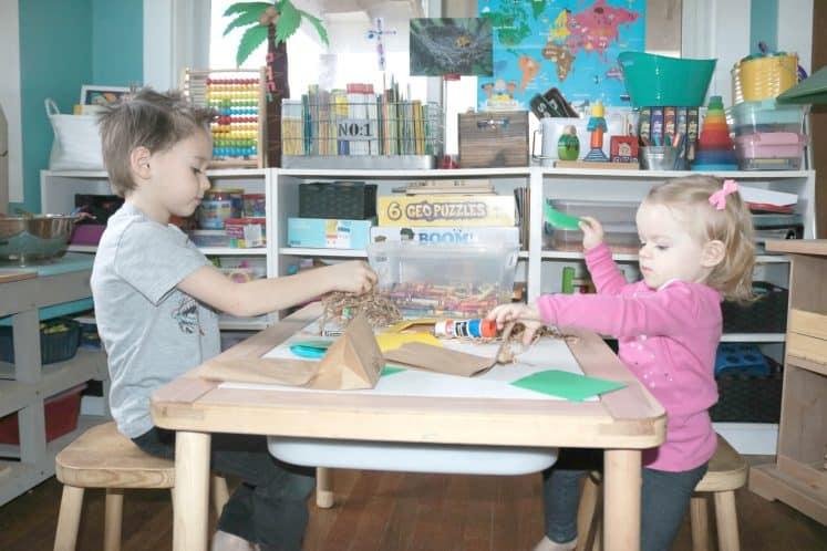 toddler and first grader making bird nest crafts together
