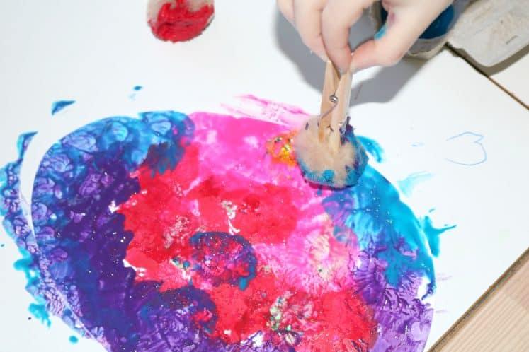 preschooler making egg process art