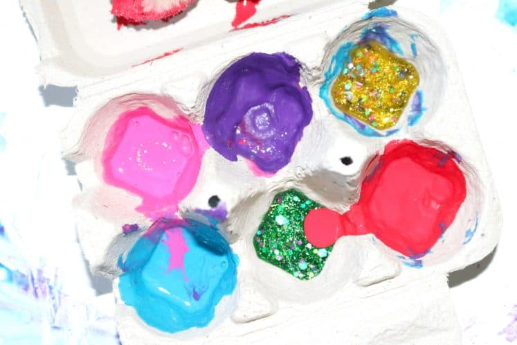 egg carton with paint spilled over the sides