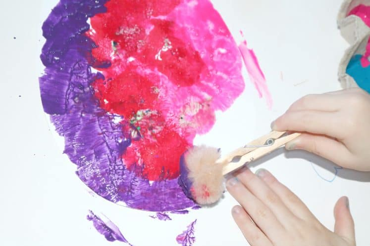preschool painting with pompom attached to clothespin