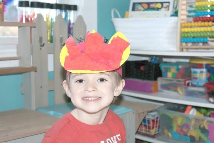 child wearing raining fire headband craft