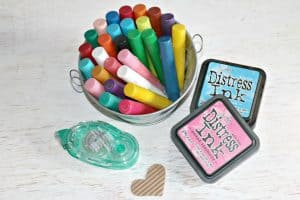 bucket of Gelatos next to Distress inks, tape runner and heart embellishment