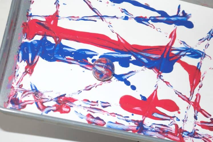 patriotic process art using small ball and paint