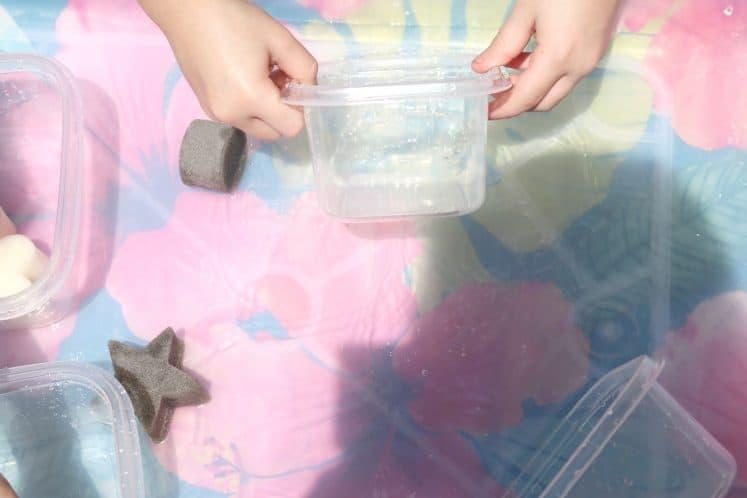 preschooler dumping bowl of water