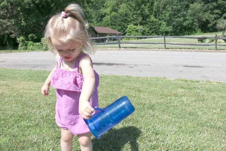 toddler pouring water
