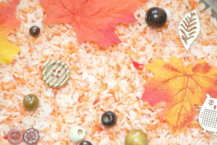 autumn sensory tray with wooden beads and buttons