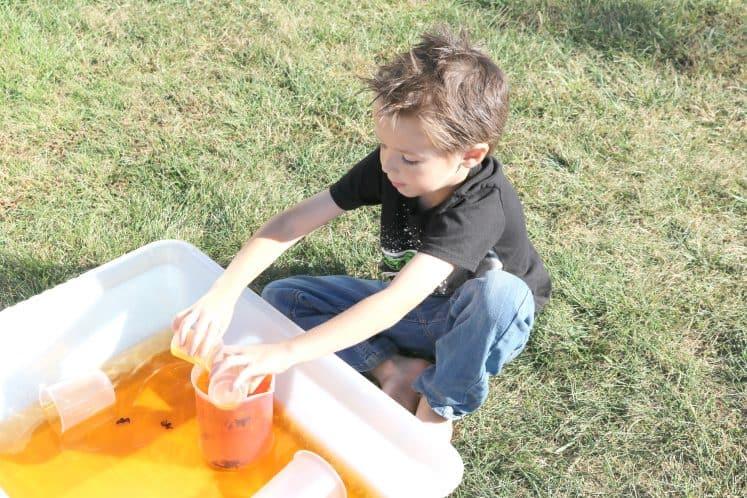 preschooler exploring Halloween sensory bin
