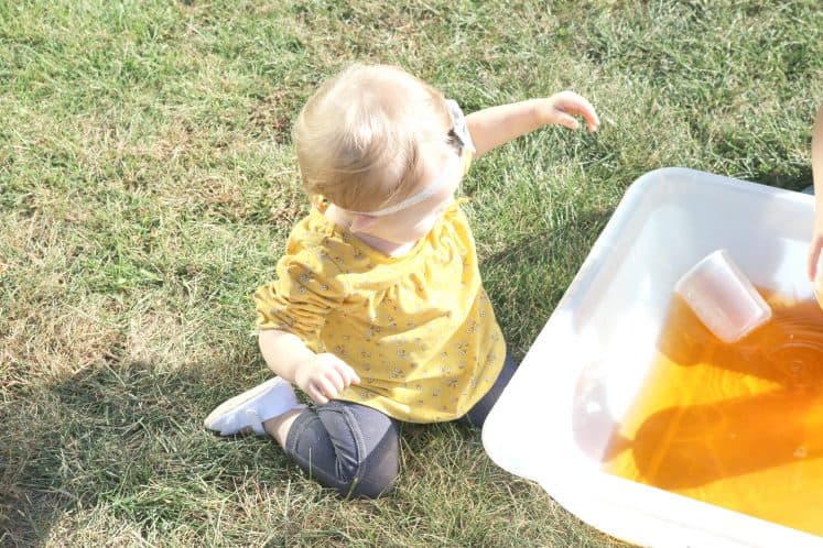 toddler exploring Halloween sensory bin