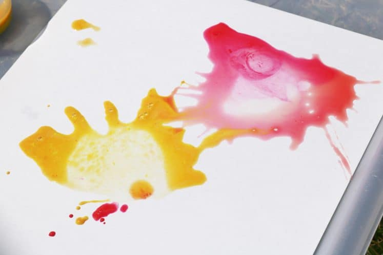 red and yellow paint splatters on paper