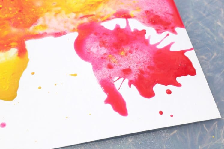 red paint splatters on blow painting process art