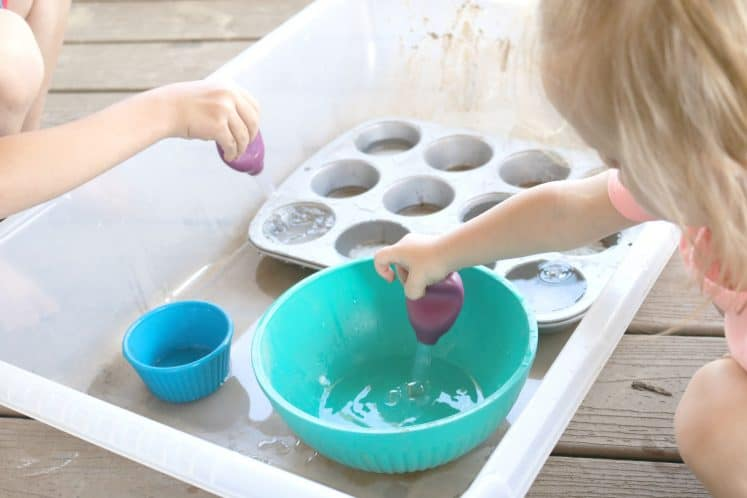 toddler and preschooler playing with water sensory tray