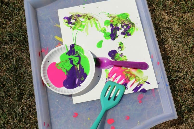 paint and kitchen utensils on tray