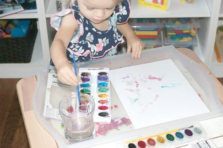 preschooler painting self-portrait with watercolors