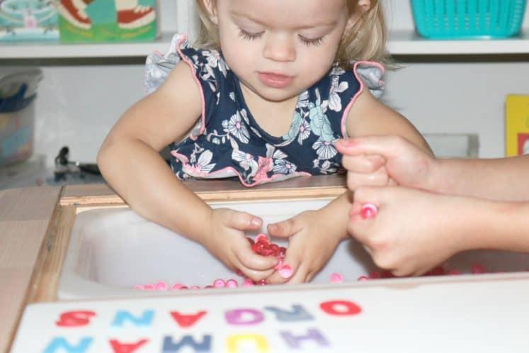 preschooler exploring water beads