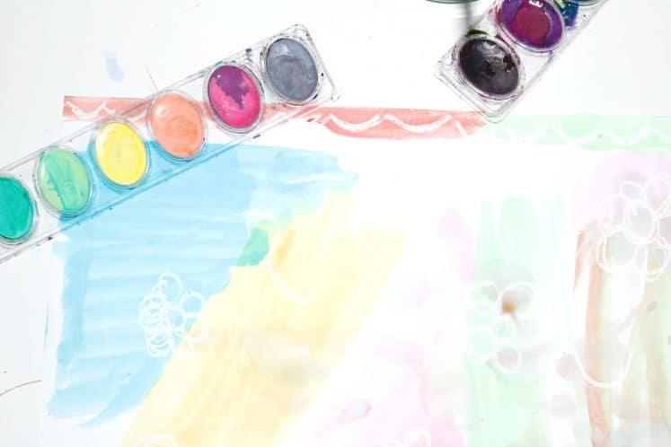 watercolor paint palette on preschooler's wax resist painting