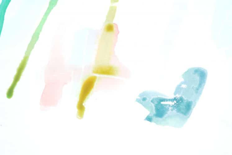 child's watercolor resist painting with drip effect