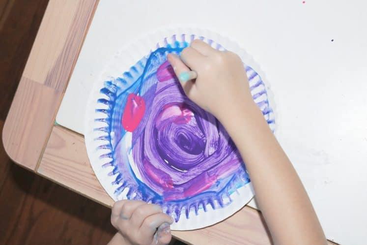 child exploring tornados by making swirl art
