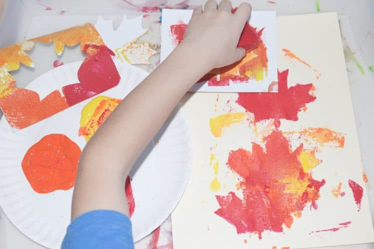 child making autumn process art
