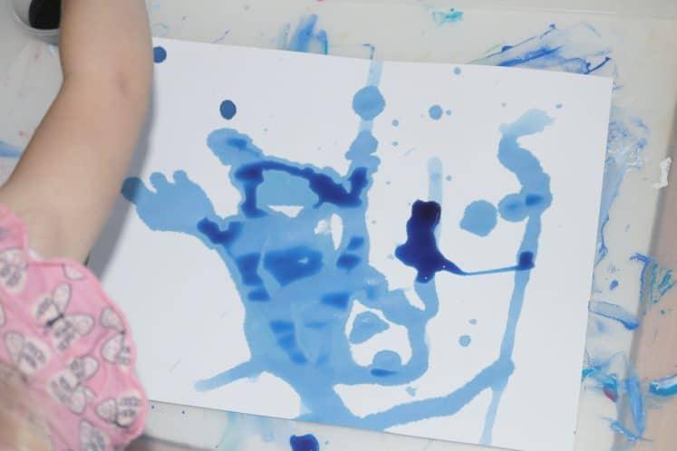 preschooler making rainy windows spring process art using eyedropper