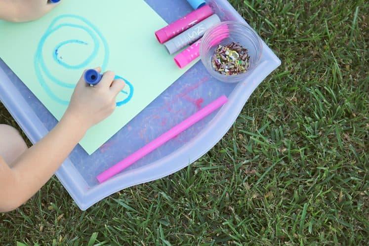 child drawing wind swirls