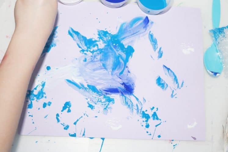 child making snowstorm winter process art