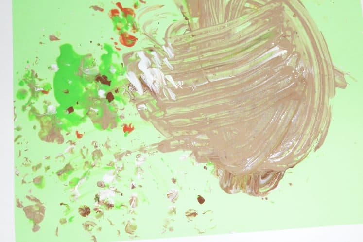 brown paint swirled on cardstock to make rainforest process art