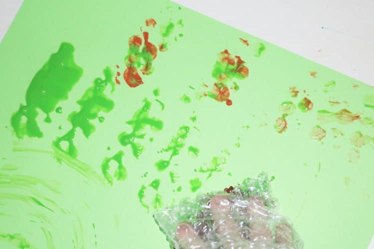 preschooler's bubble wrap rainforest texture painting that resembles snakeskin