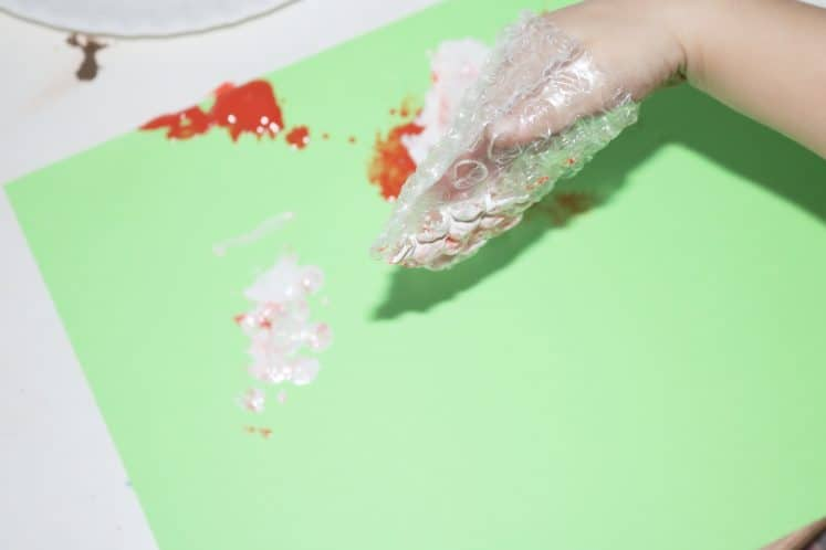 preschool making texture on cardstock using bubble wrap and paint