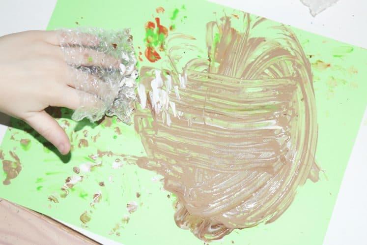 brown paint swirl on cardstock