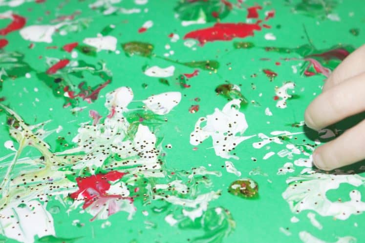 pinecone painting with splatters of paint