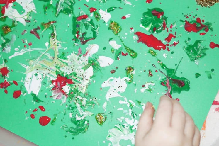 preschooler's pinecone painting on cardstock