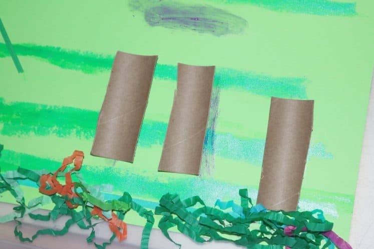 cardstock with cardboard tubes to create rainforest collage for kids