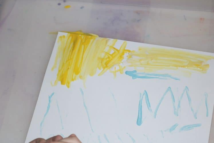 child painting tree process art using cotton swab and paint