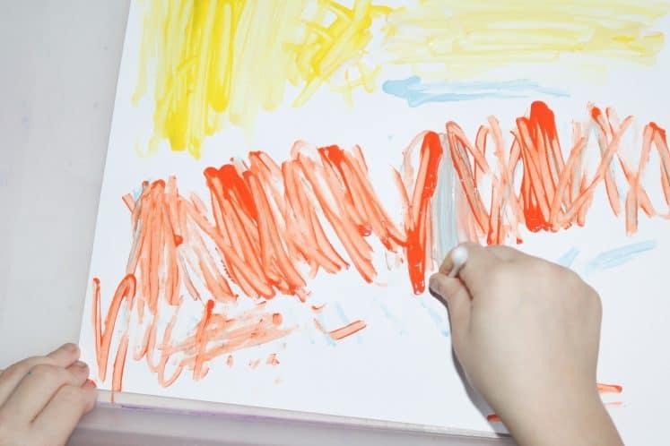 child painting using cotton swab