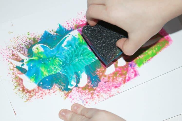 child sponge painting dinosaur art