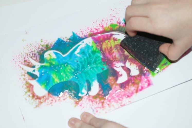 child's dinosaur process art