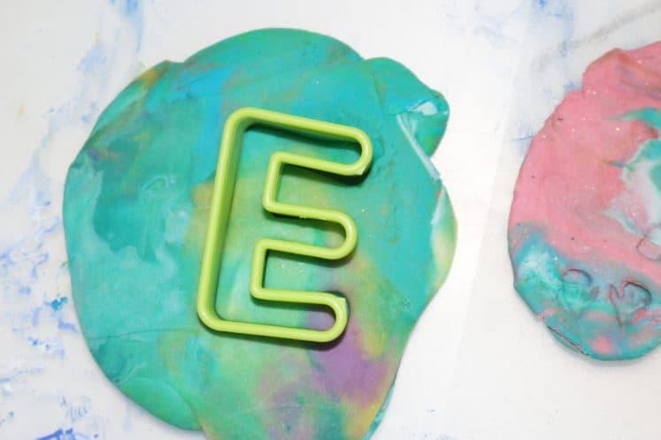 letter cookie cutter in playdough