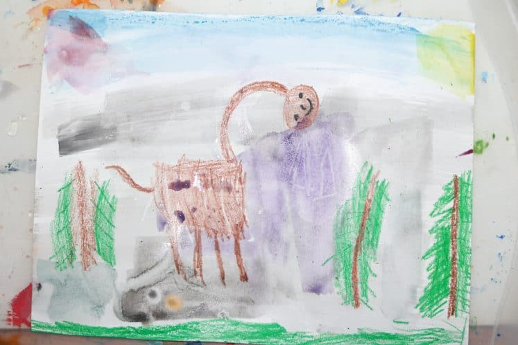 dinosaur resist process art created by young child