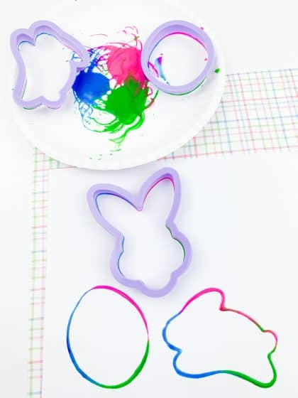 Easter egg, bunny, and rabbit stamped on white cardstock using cookie cutters and paint