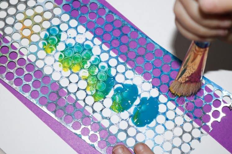 preschooler painting on punchinella