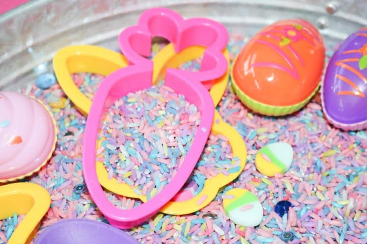stacked cookie cutters in Easter Sensory Bin