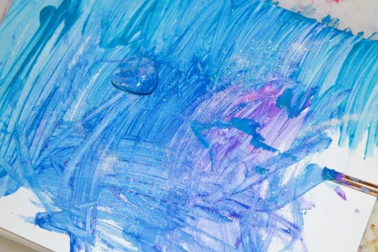 child making galaxy painting