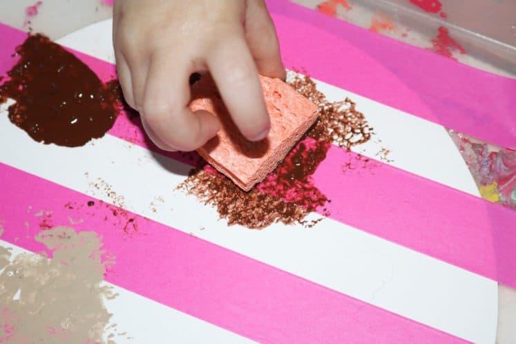 child sponge painting planet process art
