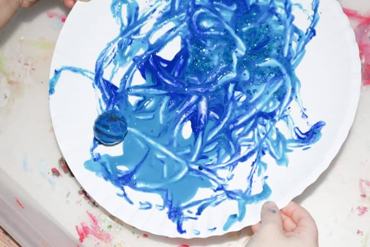 ball painting on paper plate