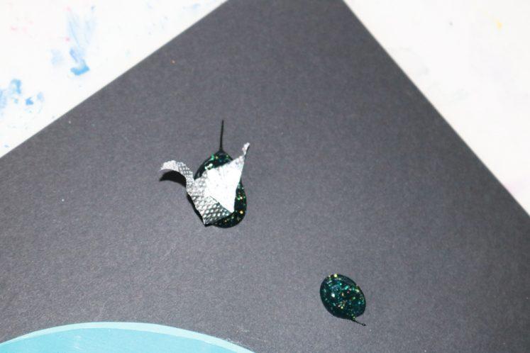 small piece of aluminum foil glued on black cardstock