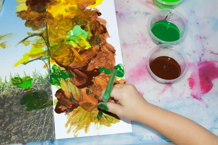 preschooler working on flower painting for kids