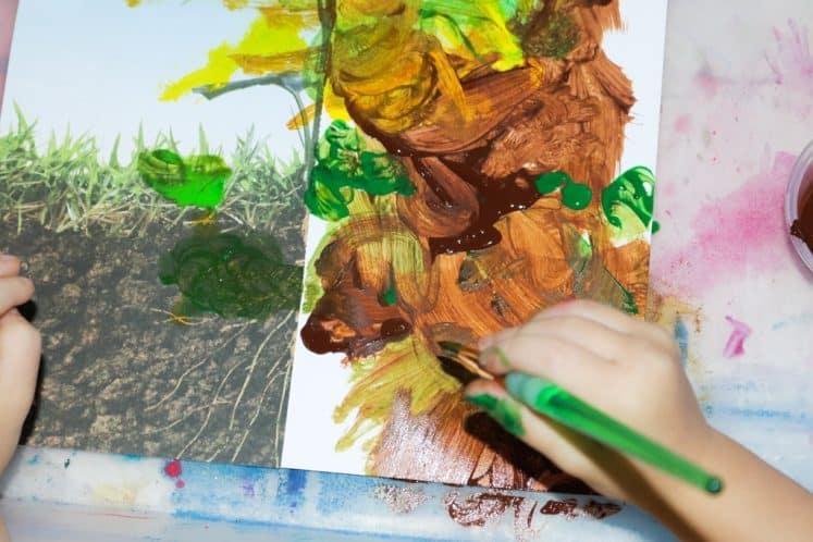 preschooler painting flower roots
