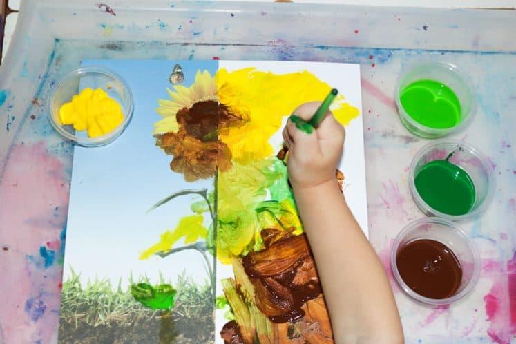 preschooler painting sunflower